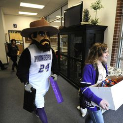 Air Force Tech Sgt. Edward Goettig wore the Pioneer Pete mascot at Lehi High School as he returned home a week earlier than originally planned and surprised his daughter Bailee, 16, at school on Thursday, March 6, 2014. Goettig had been deployed to Afghanistan since Aug. 27, 2013.