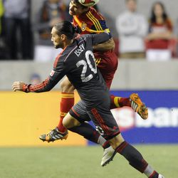 Real Salt Lake defender Tony Beltran (2) heads the ball over Toronto FC midfielder Issey Nakajima-Farran (20) during a game at Rio Tinto Stadium in Sandy on Saturday, March 29, 2014.