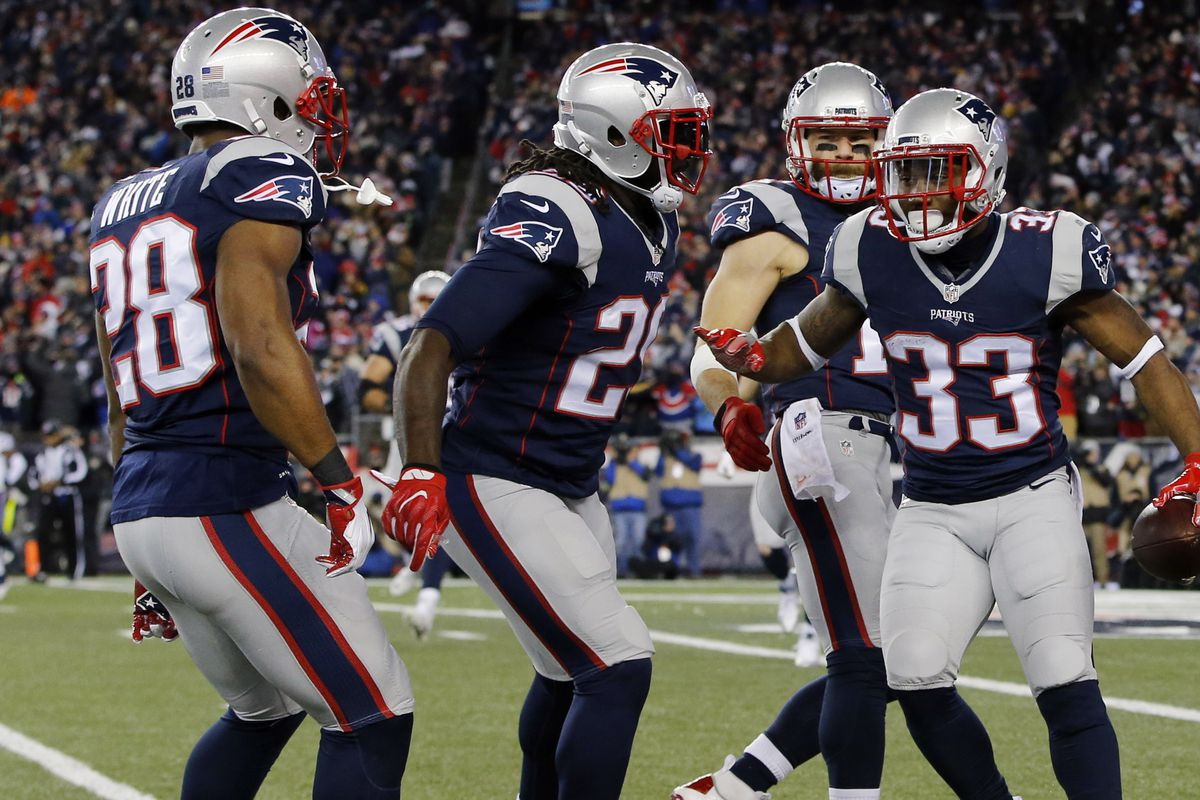 White, Blount and Lewis celebrate touchdowns together