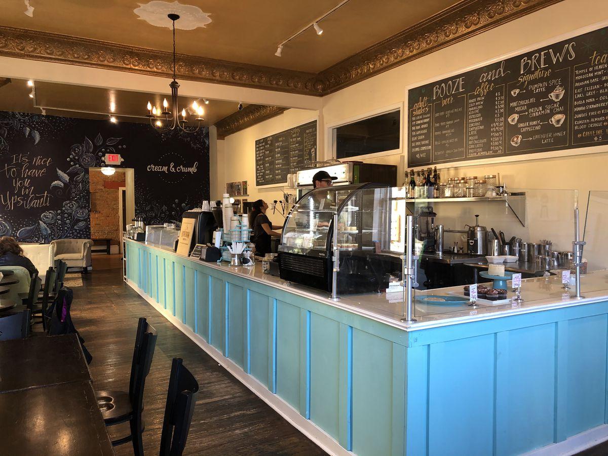 A cafe with a robin's egg blue bar.