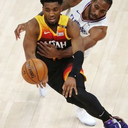Utah Jazz guard Donovan Mitchell (45) drives on LA Clippers forward Kawhi Leonard (2) during Game 2 of the Western Conference semifinalsin Salt Lake City on Thursday, June 10, 2021.