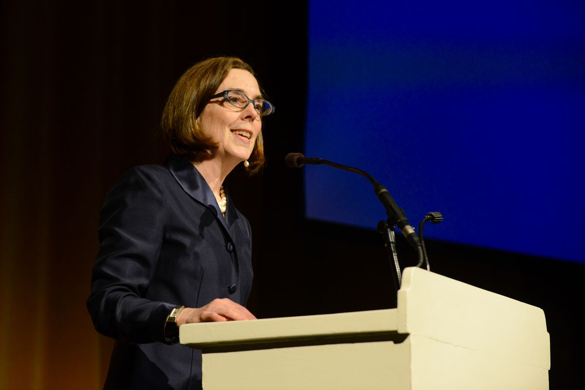 Oregon Governor Kate Brown stands at a podium