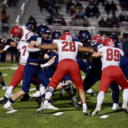 American Fork's Bodie Scchoonover, shown here playing against Herriman, had two 10-tackle games as a senior for the Cavemen in 2019, including one against the Mustangs.