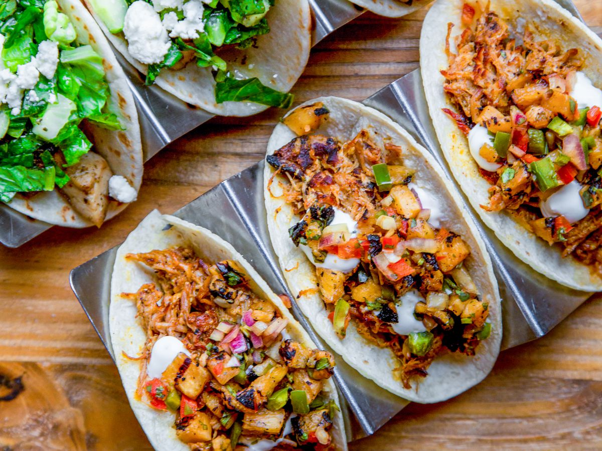 Three tacos on a plate.