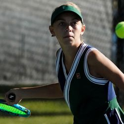Bailey Huebner, of Green Canyon, returns a shot shot Erika Olsen, of Bear River, during the final singles match of the 4A girls tennis state tournament at Liberty Park Tennis Center in Salt Lake City on Saturday, Oct. 2, 2021.