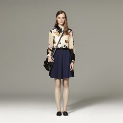 Blouse in Floral Paper Print, $29.99; Silky Skirt in Navy, $29.99; Mini Satchel in Black, $34.99