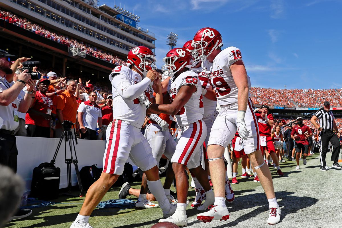 Oklahoma Sooners quarterback Caleb Williams is congratulated by running back Kennedy Brooks after a run against the Texas Longhorns during the second quarter at the Cotton Bowl.
