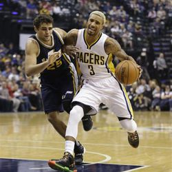 Indiana Pacers' George Hill (3) goes to the basket against Utah Jazz's Raul Neto (25) during the first half of an NBA basketball game Saturday, Oct. 31, 2015, in Indianapolis.