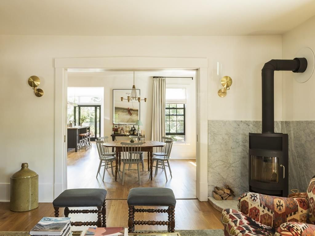 A sitting room with an antique stove.