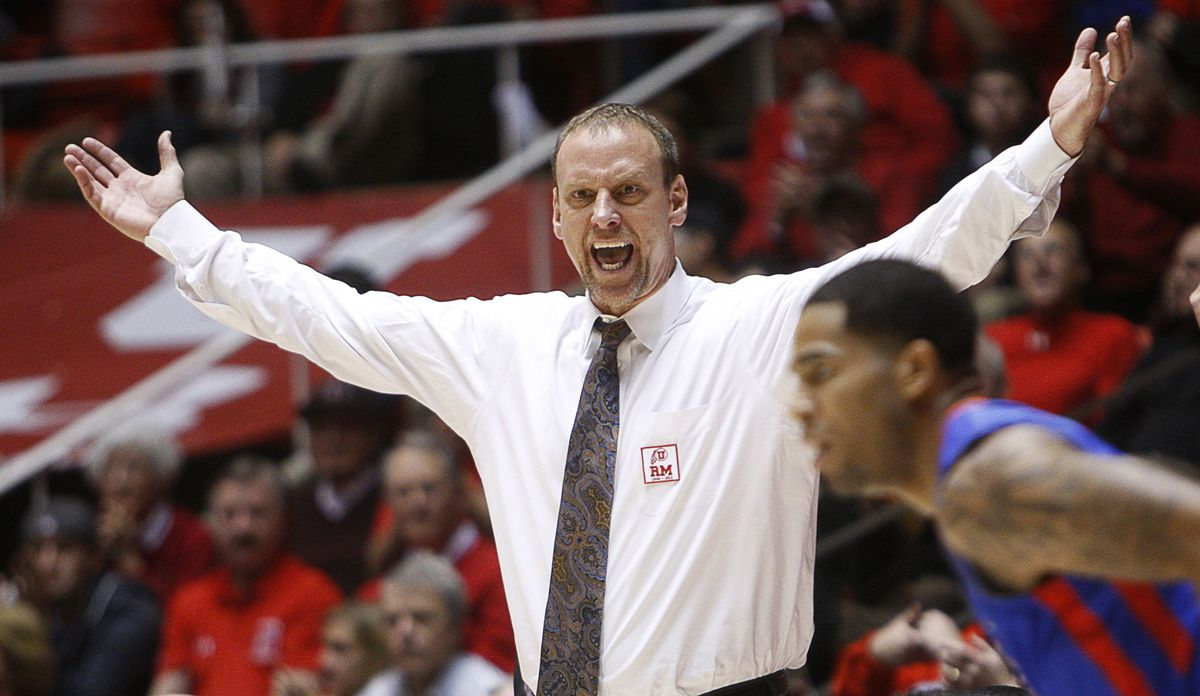 Utah Head Coach, Larry Krystkowiak yells at a referee for a foul as Utah and SMU play Tuesday, Dec. 18, 2012, in the Huntsman Center. Utah won 62-53.
