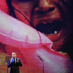 British actor Daniel Craig talks, backdropped by a projected picture of a child, during the opening ceremony of the World Humanitarian Summit, in Istanbul, Monday, May 23, 2016. World leaders and representatives of humanitarian organisations from across the globe converge in Istanbul on May 23-24, 2016 for the first World Humanitarian Summit, focused on how to reform a system many judge broken.