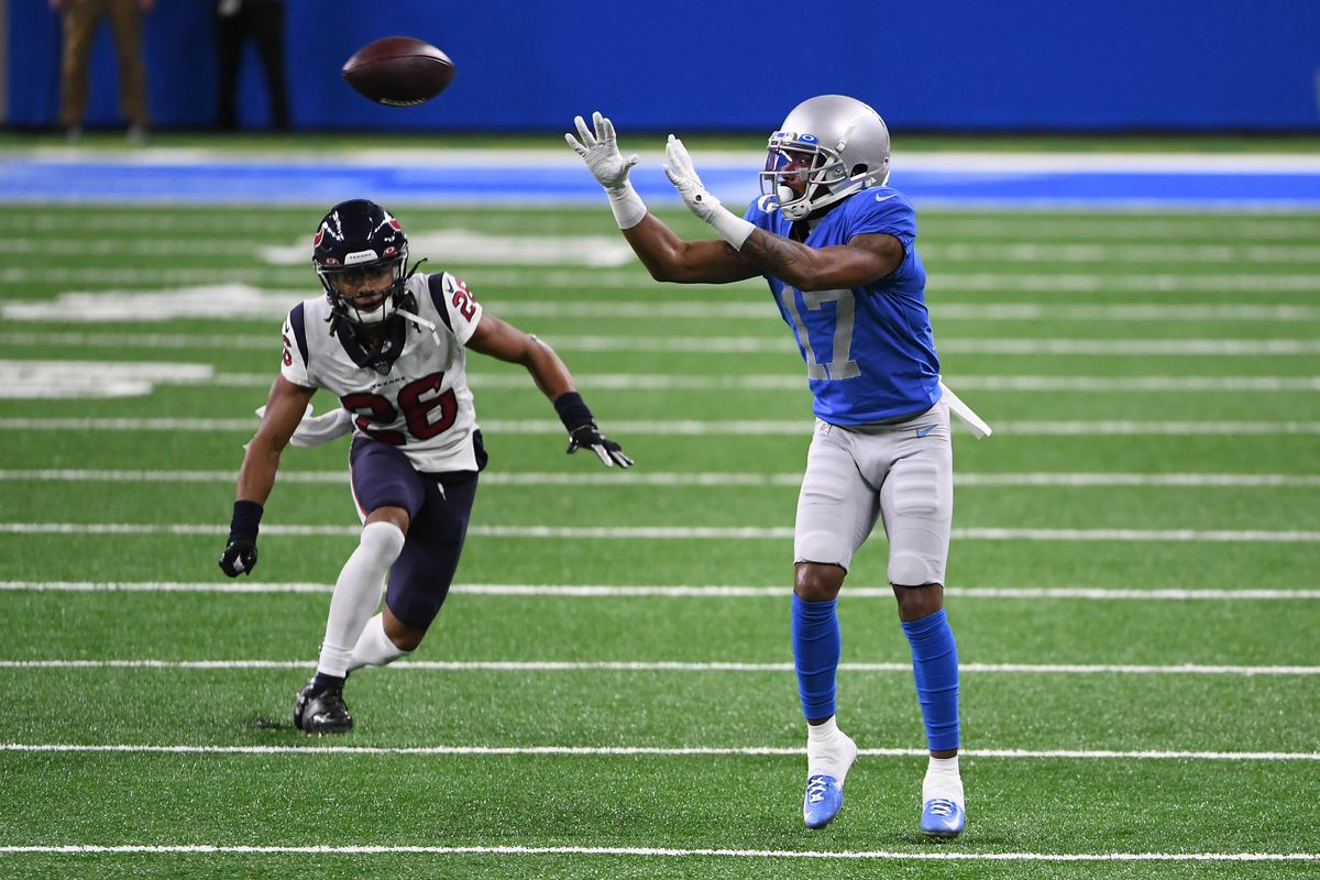 Marvin Hall #17 of the Detroit Lions catches a pass in front of Vernon Hargreaves III #26 of the Houston Texans during the second half of a game at Ford Field on November 26, 2020 in Detroit, Michigan.
