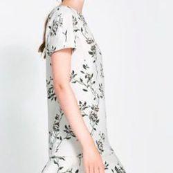 "<b>Zara</b> Neoprene Floral Dress, <a href=""http://www.zara.com/us/en/woman/dresses/floral-neoprene-dress-c269185p1451524.html"">$79.90</a>"