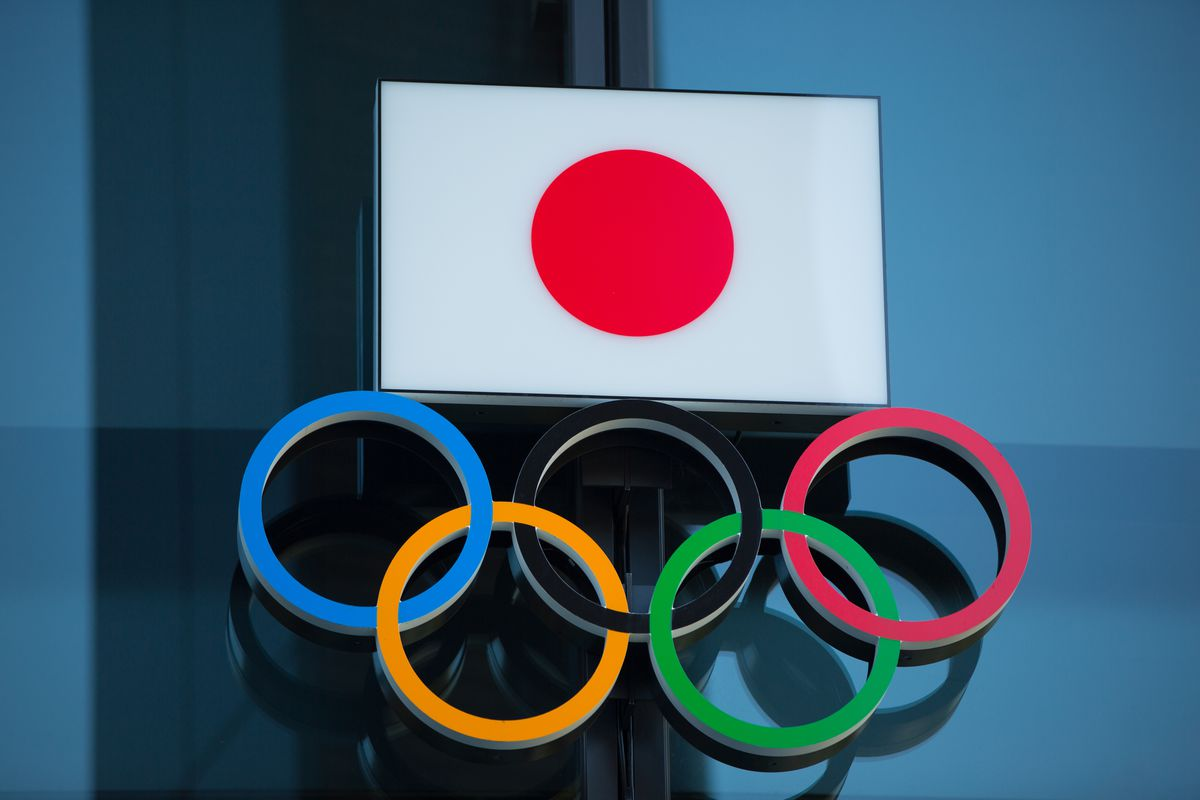 Japanese National Flag over the Olympic Rings symbol is seen...