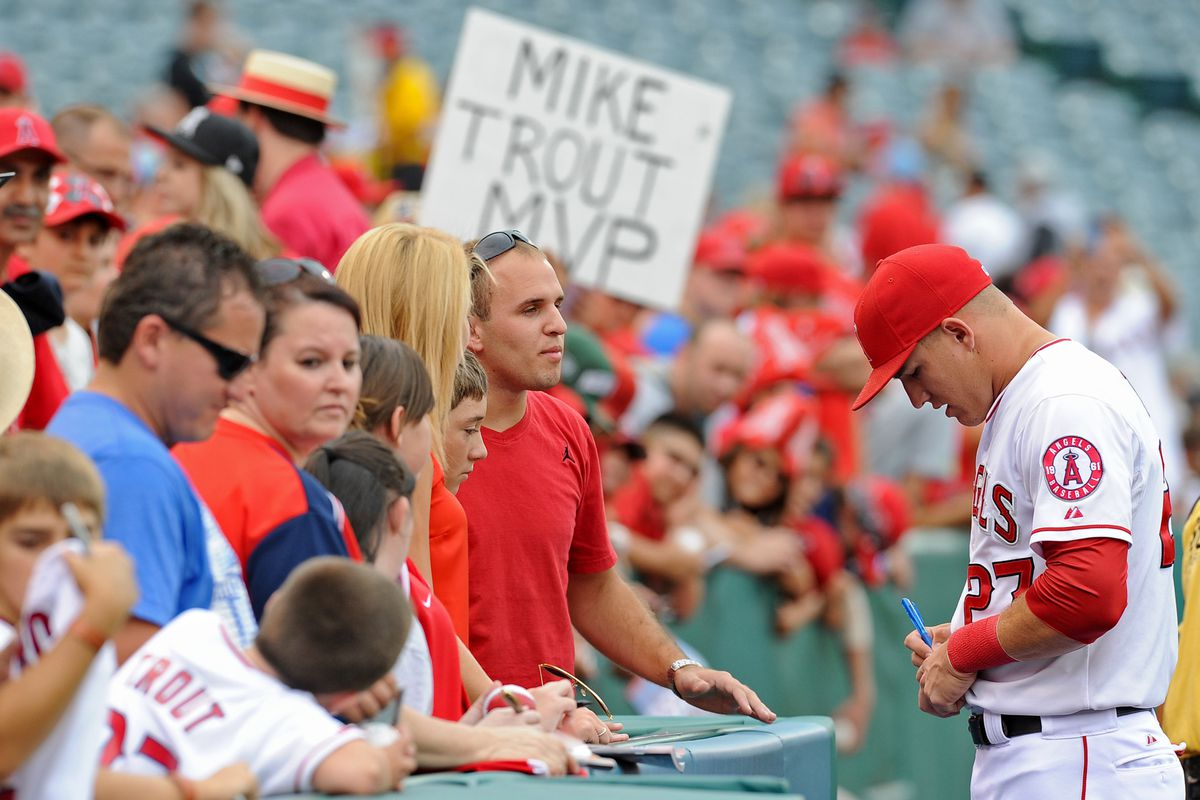 August 11, 2012; Anaheim, CA, USA; Los Angeles Angels center fielder Mike Trout (27) signs autographs before the game against the Seattle Mariners at Angel Stadium