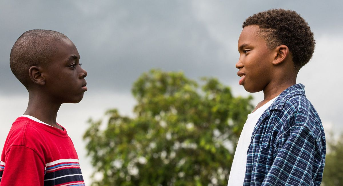 Two Black boys face each other in Moonlight