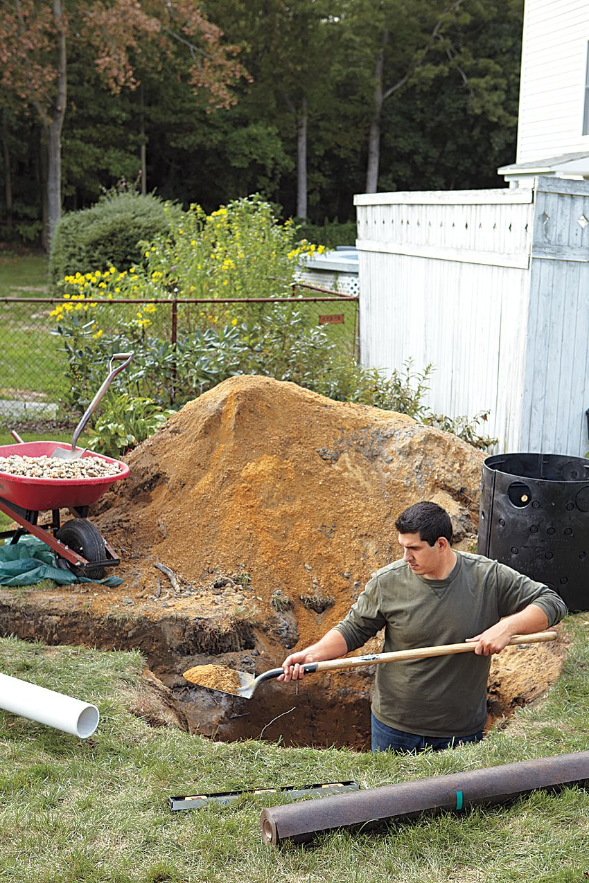 Man Digs Hole For Dry Well Installation