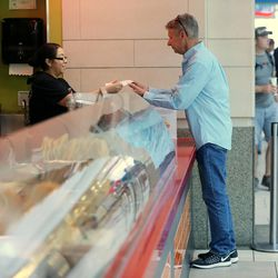 Libertarian presidential candidate Gov. Gary Johnson orders lunch at Taste of Red Iguana at the food court at City Creek Center as he and running mate Gov. Bill Weld pay a visit to Salt Lake City for a speech at the University of Utah on Saturday, Aug. 6, 2016.