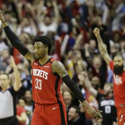 Houston Rockets forward Robert Covington (33) reacts after making a three point basket late in the second half of an NBA basketball game against the Utah Jazz, Sunday, Feb. 9, 2020, in Houston.