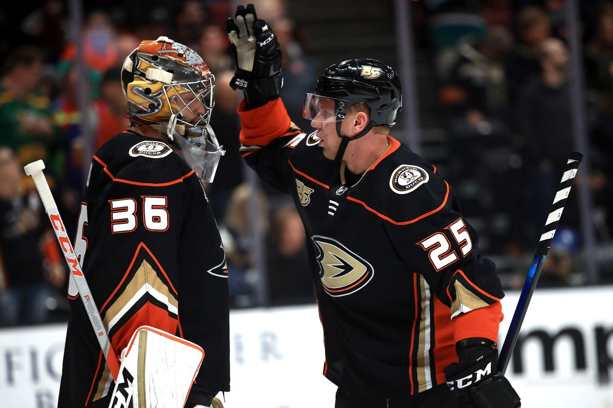 ANAHEIM, CA - NOVEMBER 21: Ondrej Kase #25 talks with John Gibson #36 of the Anaheim Ducks after scoring a goal during the second period of a game against the Vancouver Canucks at Honda Center on November 21, 2018 in Anaheim, California.