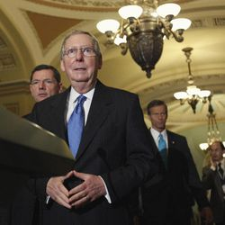 In this Aug. 2, 2011, file photo the Senate Minority Leader, Republican Mitch McConnell of Kentucky, approaches the podium for a Capitol Hill news conference after the Senate passed debt-ceiling legislation.