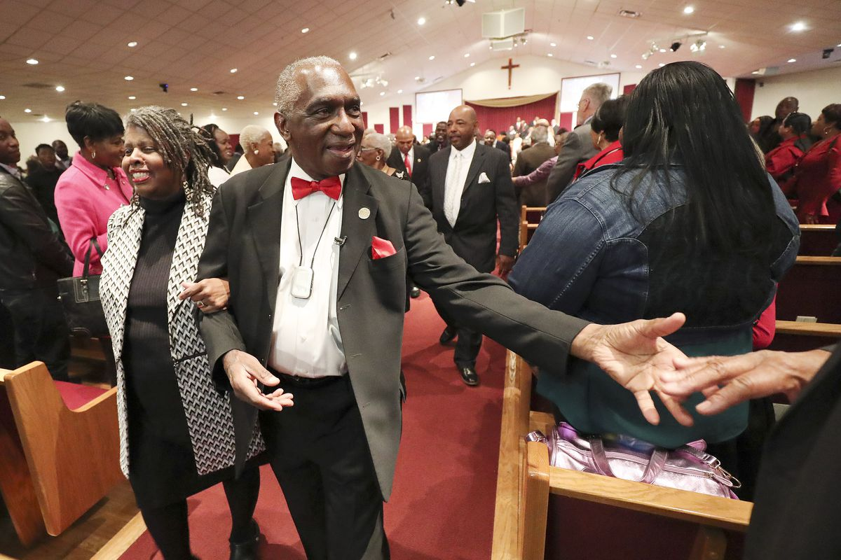 Pastor France A. Davis greets people as he walks down the aisle after giving his final sermon at Calvary Baptist Church in Salt Lake City on Sunday, Dec. 29, 2019.