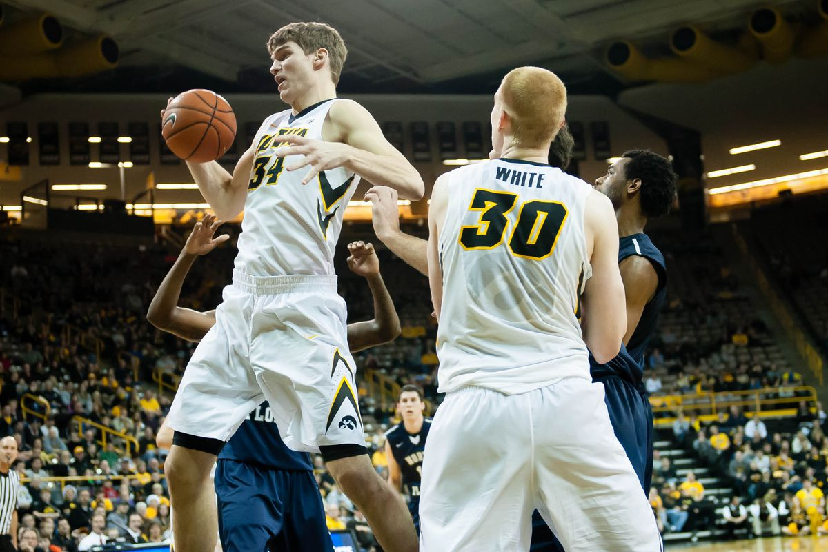 Adam Woodbury (34) and Aaron White (30) will need to play well at Wisconsin to have a shot at a win