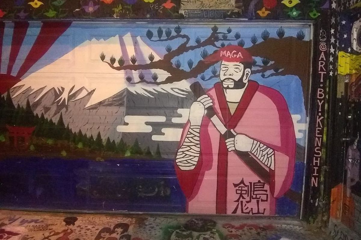 A painting of a Japanese man in a robe holding a sword, with a red cap with the the letters MAGA crudely added.