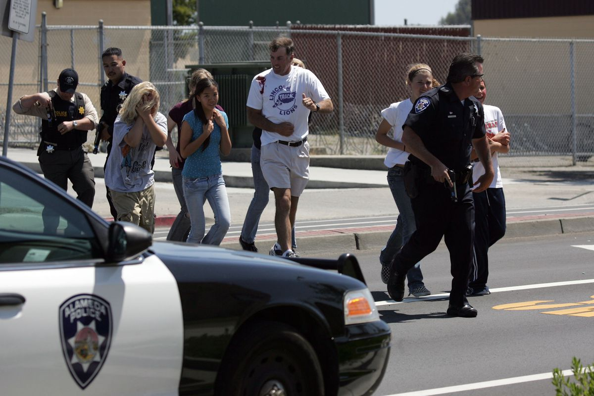 Students wearing makeup to simulate being victims of a school shooting are evacuated during a drill in Alameda, California, in 2007.
