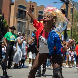 A performer dressed as Harley Quinn dances during the Bud Billiken Parade in the Bronzeville neighborhood Saturday.