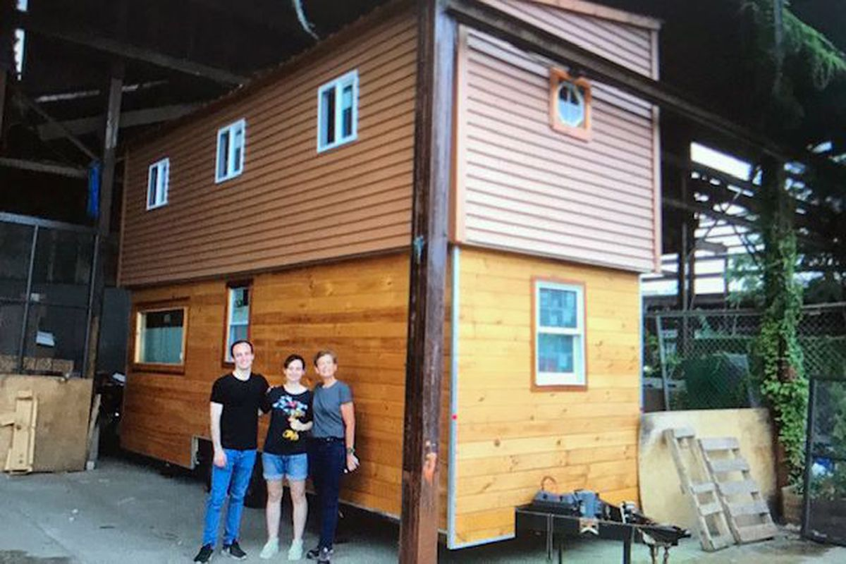 From left to right, Tom Saat's son Deniz, daughter Emel and wife Deb, in front of their tiny house in an Astoria warehouse.