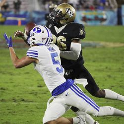 Brigham Young Cougars wide receiver Dax Milne (5) can't make the catch under defense firm UCF Knights defensive back Jermaine McMillian (26) during the Boca Raton Bowl in Boca Raton, Fla., on Tuesday, Dec. 22, 2020.