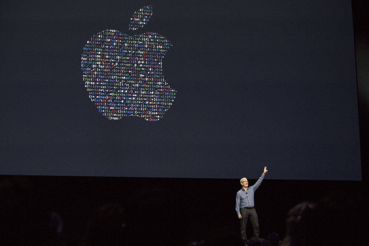 Apple CEO Tim Cook waves good bye after speaking at an Apple event
