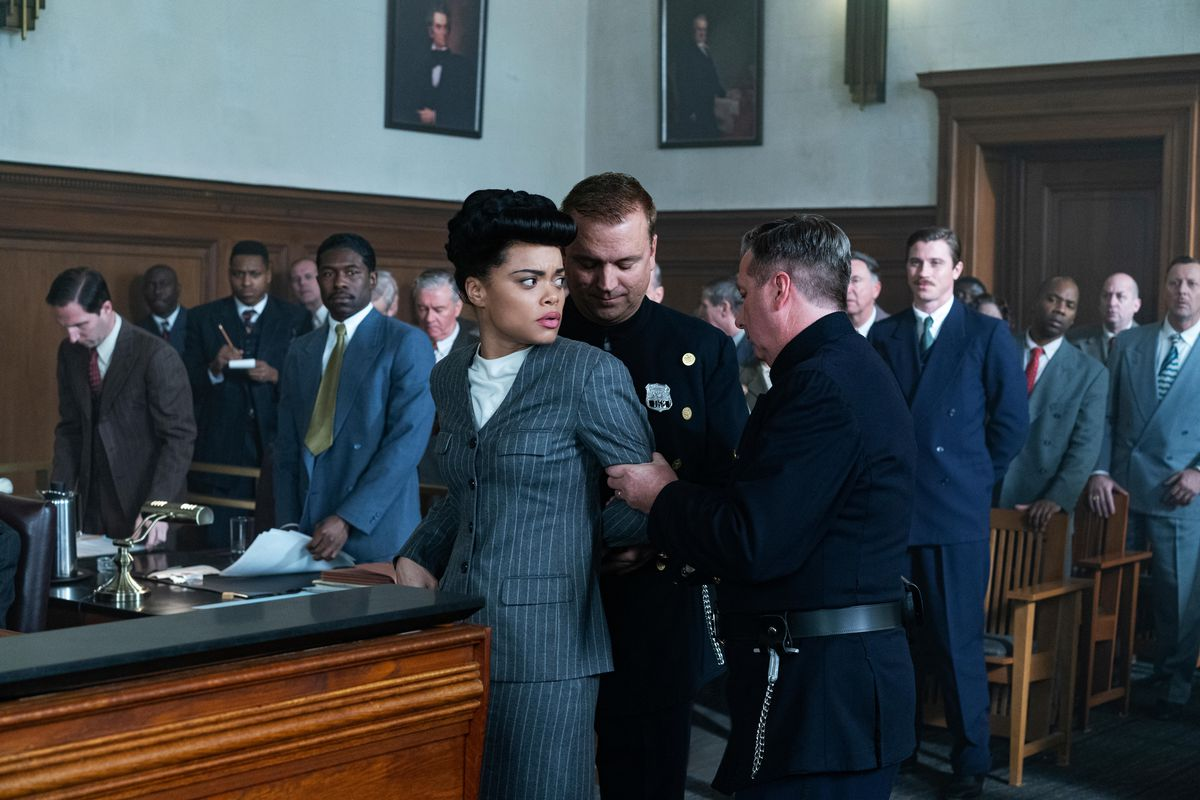 Andra Day as Billie Holiday is taken into custody in a crowded courtroom in The United States vs. Billie Holiday