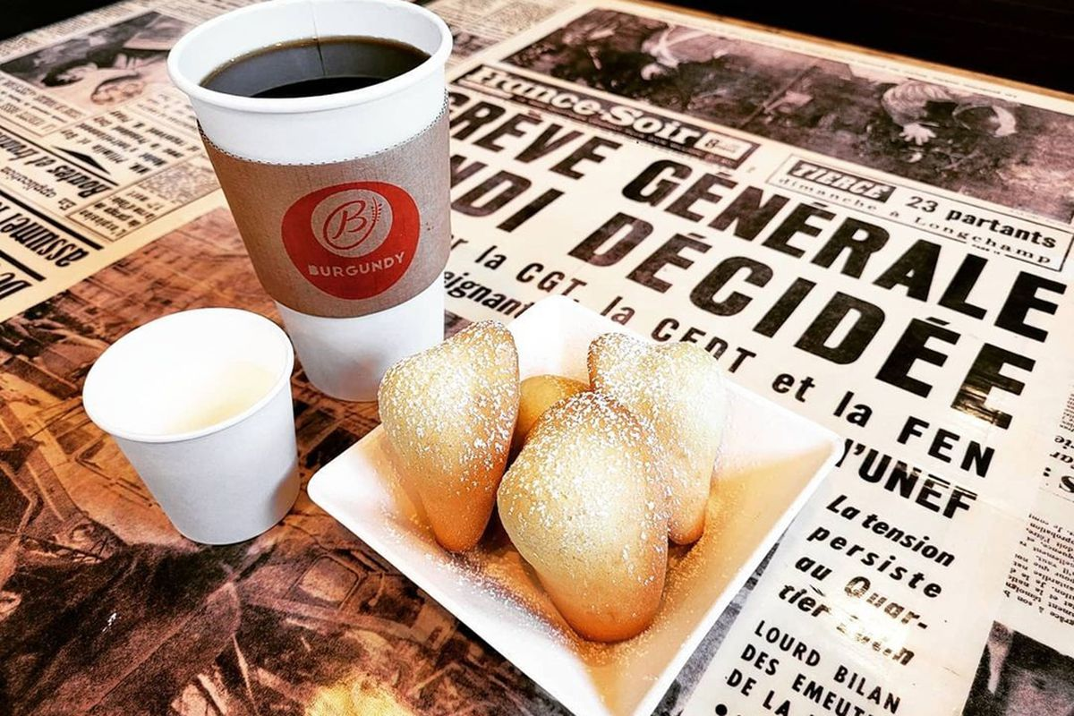 Madelines and coffee, now being served at Burgundy French Bakery Cafe & Bistro at the westside's Village Square.