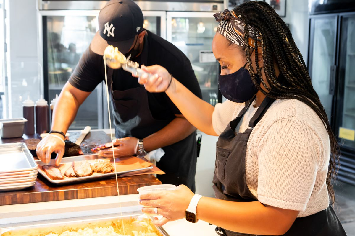 Nina Horn (right) scoops a portion of stretchy mac and cheese