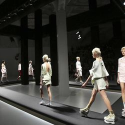 Models wear creations part of the Prada Women's Spring-Summer 2013 fashion collection, during the fashion week in Milan, Italy, Thursday, Sept. 20, 2012.