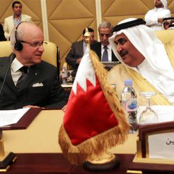 Bahrain's Foreign Minister Sheikh Khaled bin Ahmad al-Khalifa,Right, Speaks Algerian Minister of Foreign Affairs Mourad Medelci during the meeting of the Committee of Ministers of the Arab League to discuss the situation in Syria taking place in Doha, Tuesday 17, April 2012.