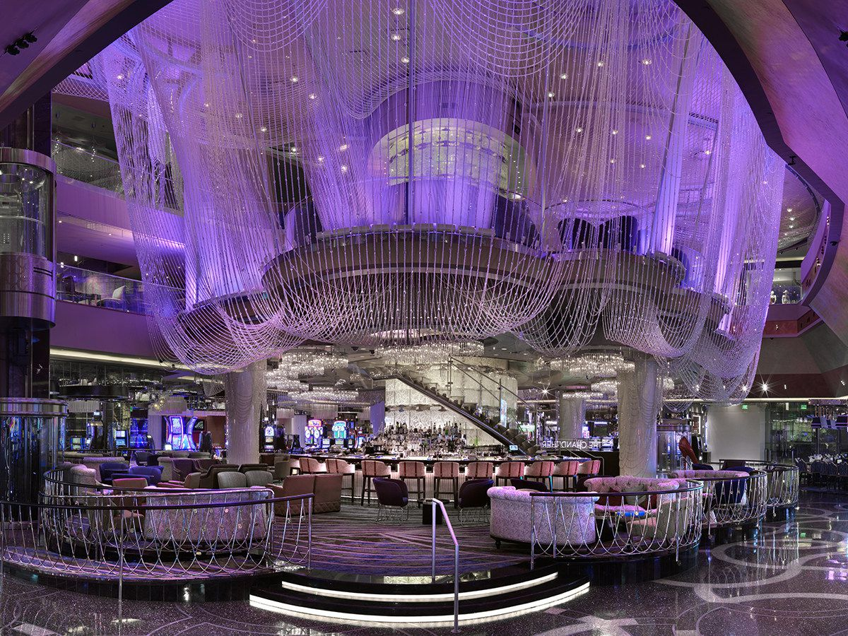 The lower level of a bar shrouded in crystals lit up in purple