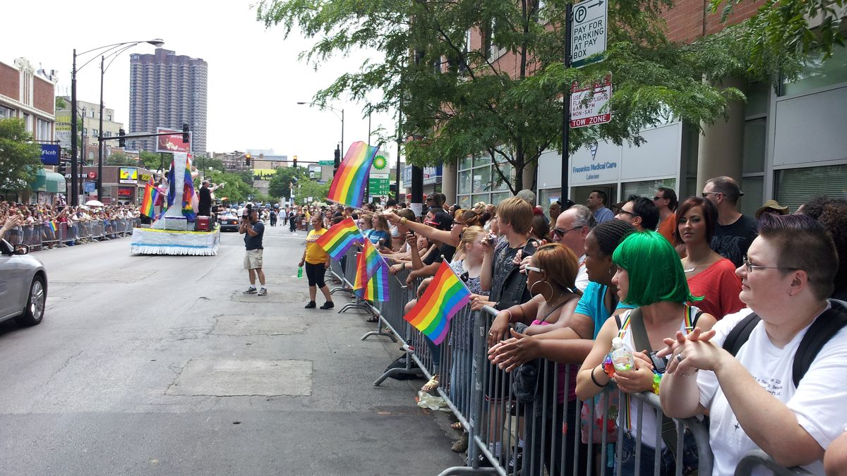 Onlookers watch the 2012 Pride Parade