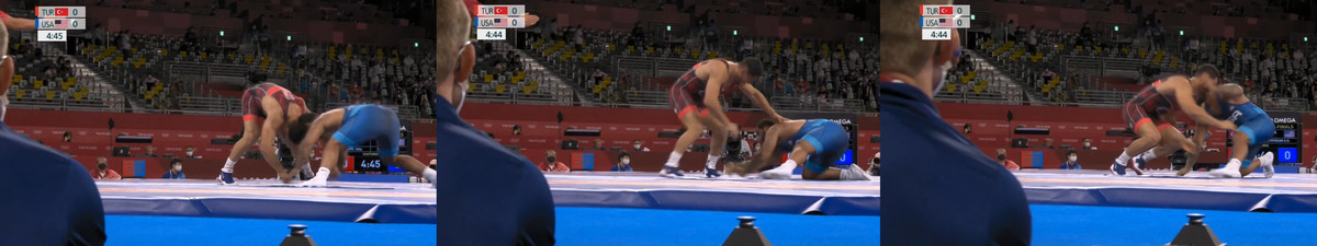 Taha Akgul attempts to score on Gable Steveson at the Tokyo Olympics