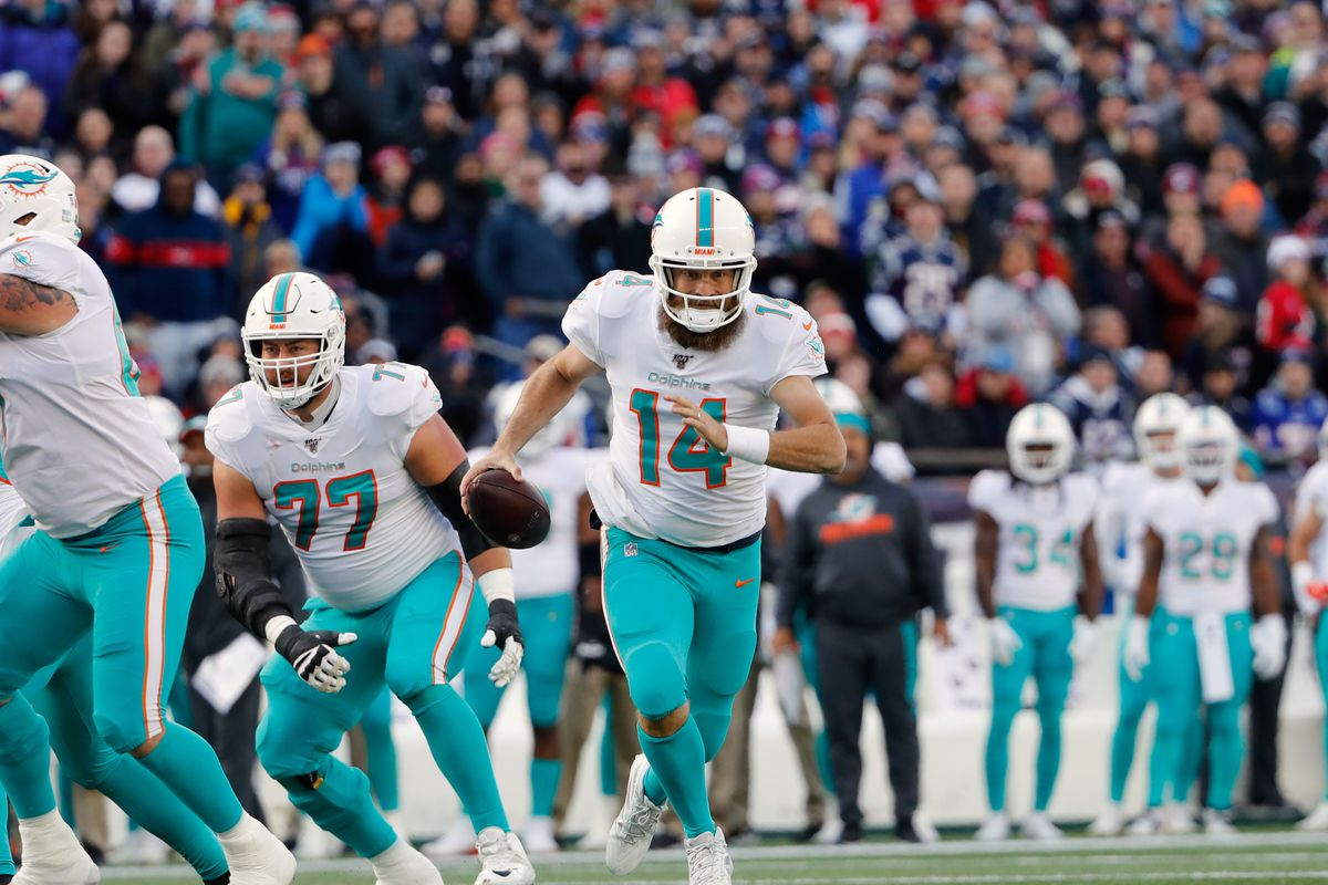 Miami Dolphins quarterback Ryan Fitzpatrick runs the ball against the New England Patriots during the first half at Gillette Stadium.