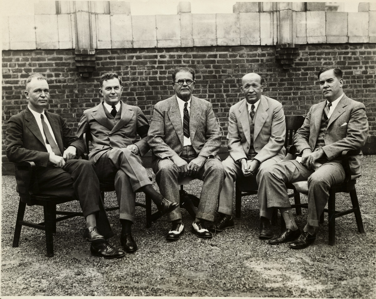 """The famous coaches on the All-American Board of Football during the dinner at the New York Athletic Club, left to right: W.A. Alexander of Georgia Tech; Tad Jones of Yale; Glenn """"Pop"""" Warner of Stanford, the chairman; Knute Rockne of Notre Dame; and Christy Walsh."""