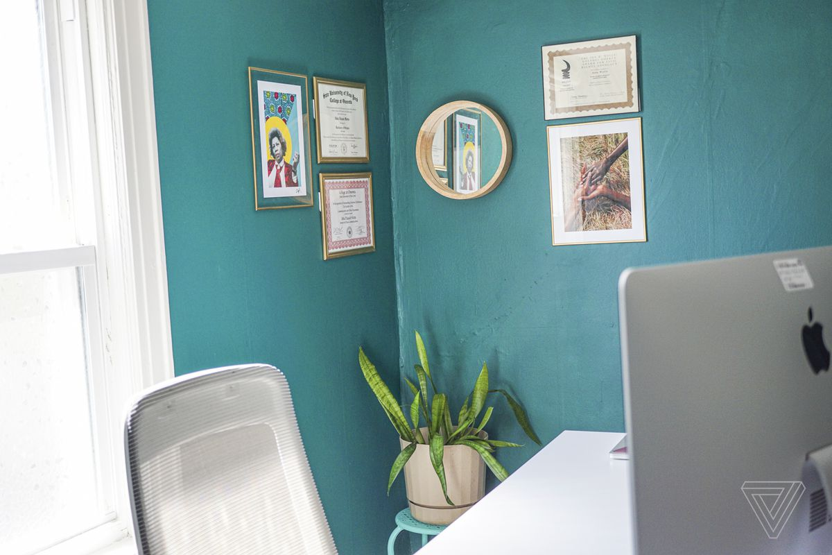 A Toni Morrison print by Zoë Sinclair (on the wall, left) and Medusa, the snake plant.