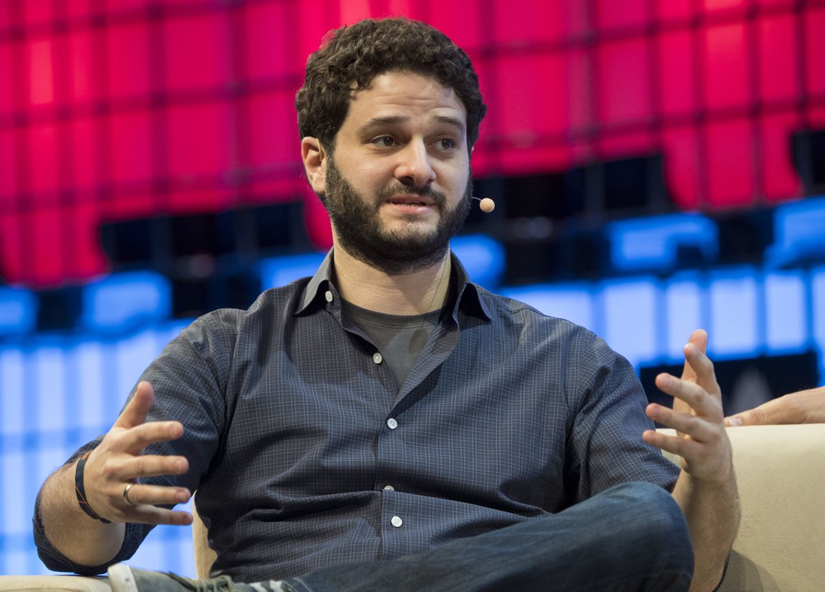 Dustin Moskovitz on stage at at conference.