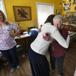 Nicole Maynes, a certified nursing assistant for Visiting Angels, left, smiles as Kathy Sorenson, community relations director for Visiting Angels, hugs Janet Janis, a client of the in-home senior care company, in Janis' Salt Lake City home on Wednesday, Feb. 12, 2020. Maynes and Sorenson surprised Janis with flowers and hugs as part of the company's effort to deliver hugs to their clients the week of Valentine's Day.