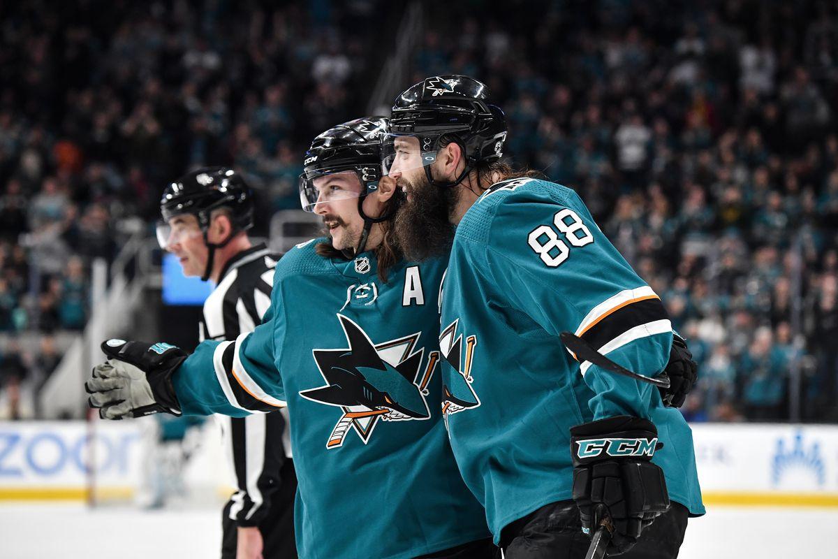 Brent Burns #88 and Erik Karlsson #65 of the San Jose Sharks celebrate scoring a goal against the Dallas Stars at SAP Center on January 11, 2020 in San Jose, California.