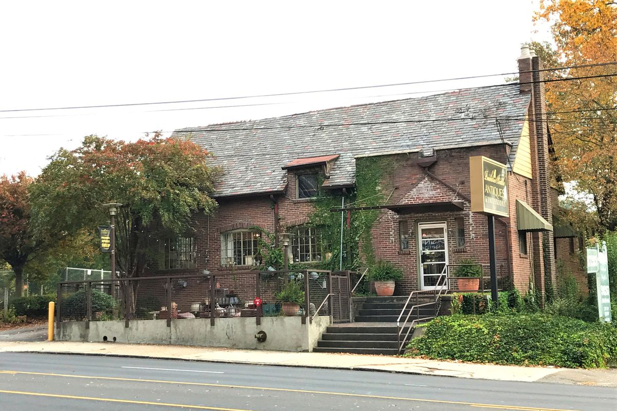 A two-story cottage-like commercial building.