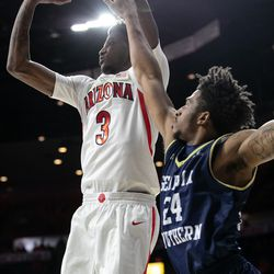 Arizona's Dylan Smith (3) shoots past a hand in the face from Georgia Southern's David-Lee Jones Jr. during the Arizona-Georgia Southern game in McKale Center on November 29 in Tucson, Ariz.