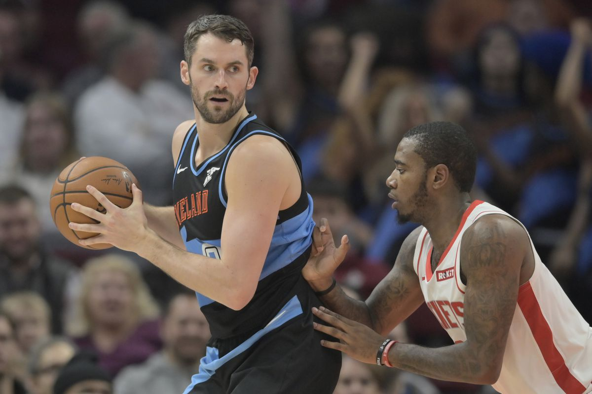 Houston Rockets forward Gary Clark defends Cleveland Cavaliers forward Kevin Love in the second quarter at Rocket Mortgage FieldHouse.